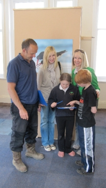 The photo shows (l to r)  Dave Mowle, Trustee of the Grand Pavilion venue, Anna-Louise Pickering, Pollyanna Pickering and (front) children Lucy Morris and Alfie Mowle