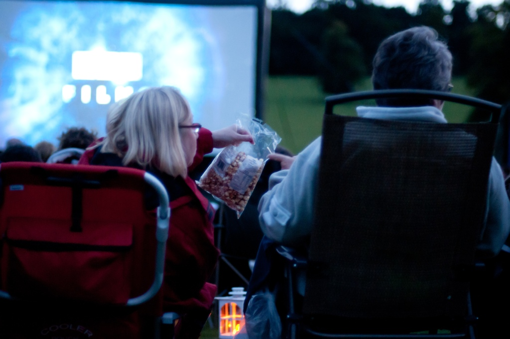 Couple watching outdoor movie