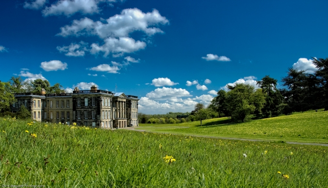 Calke Abbey, blue sky, white fluffy clouds and fresh green grass