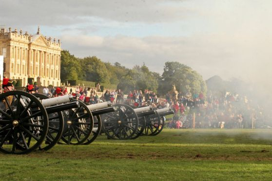 Cannons firing in front of Chatsworth House, during Chatsworth Country Fair