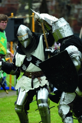 Reenactment of medieval knights in combat.