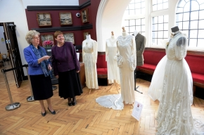 VINTAGE FASHION IN THE SPOTLIGHT: Councillors Sybil Ralphs and Gill Burton admire the gowns from a bygone era.