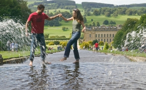 Couple splashing in the Cascade fountain at Chatsworth House