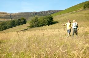 Walkers descending from Kinder Scout towards Edale